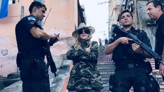 Madonna poses with police in Morro do Providencia a favela in Rio de Janeiro Brazil