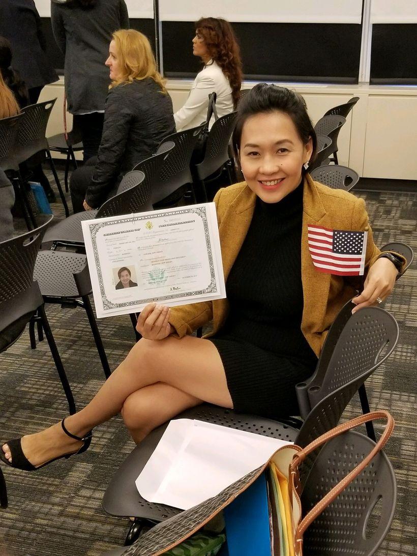 Beanne de Guzman holding her new citizenship documents