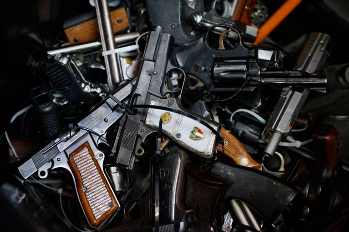 Surrendered handguns are seen during a gun buyback event at Los Angeles Sports Arena in Los Angeles, California May 31, 2014.