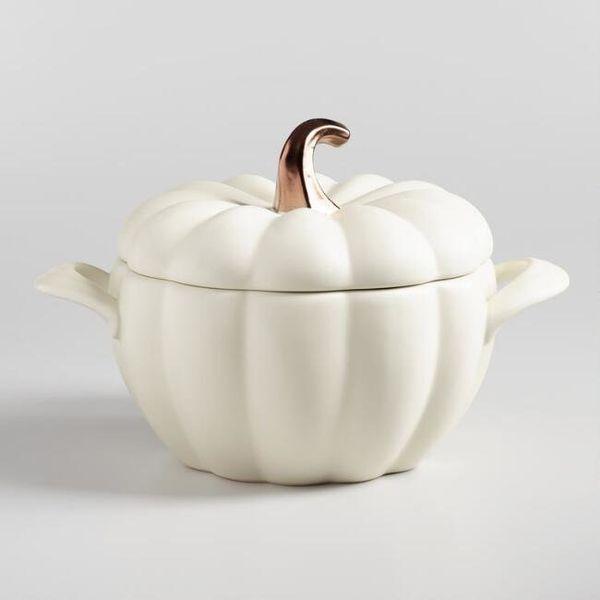 "This <a href=""https://www.worldmarket.com/product/matte+white+ceramic+pumpkin+casserole+baker.do?sortby=ourPicks&from=Sea"