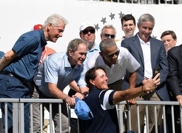 Former Presidents Bill Clinton, George W. Bush and Barack Obama pose for a selfie with Phil Mickelson...