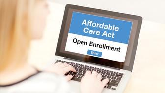A woman using a laptop computer and the internet web service, she is in the process of signing up and joining the Affordable Care Act Obamacare in the United States in the open enrollment for her healthcare insurance plan. Photographed close-up in a horizontal format.