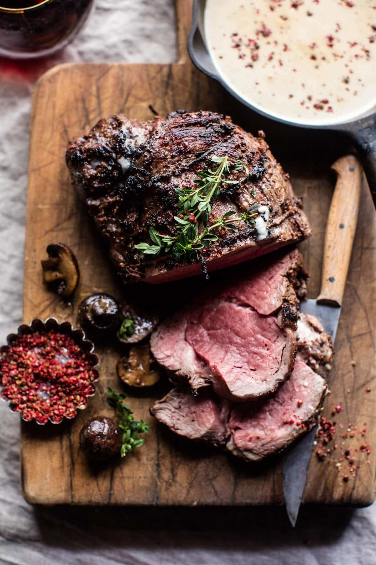 "<strong>Get the <a href=""https://www.halfbakedharvest.com/roasted-beef-tenderloin-with-mushrooms-and-white-wine-cream-sauce/"""