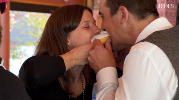 Your first kiss as a married couple can and should include a doughnut.