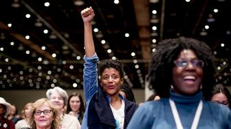 An attendee gestures during the Women's Convention in Detroit, Michigan, U.S., on Friday, Oct. 27, 2017. The Women's Convention will bring together first time activists and movement leaders, rising political stars that reflect our nation's changing demographics, and thousands of women for a weekend of workshops, strategy sessions, and inspiring forums. Photographer: Anthony Lanzilote/Bloomberg via Getty Images