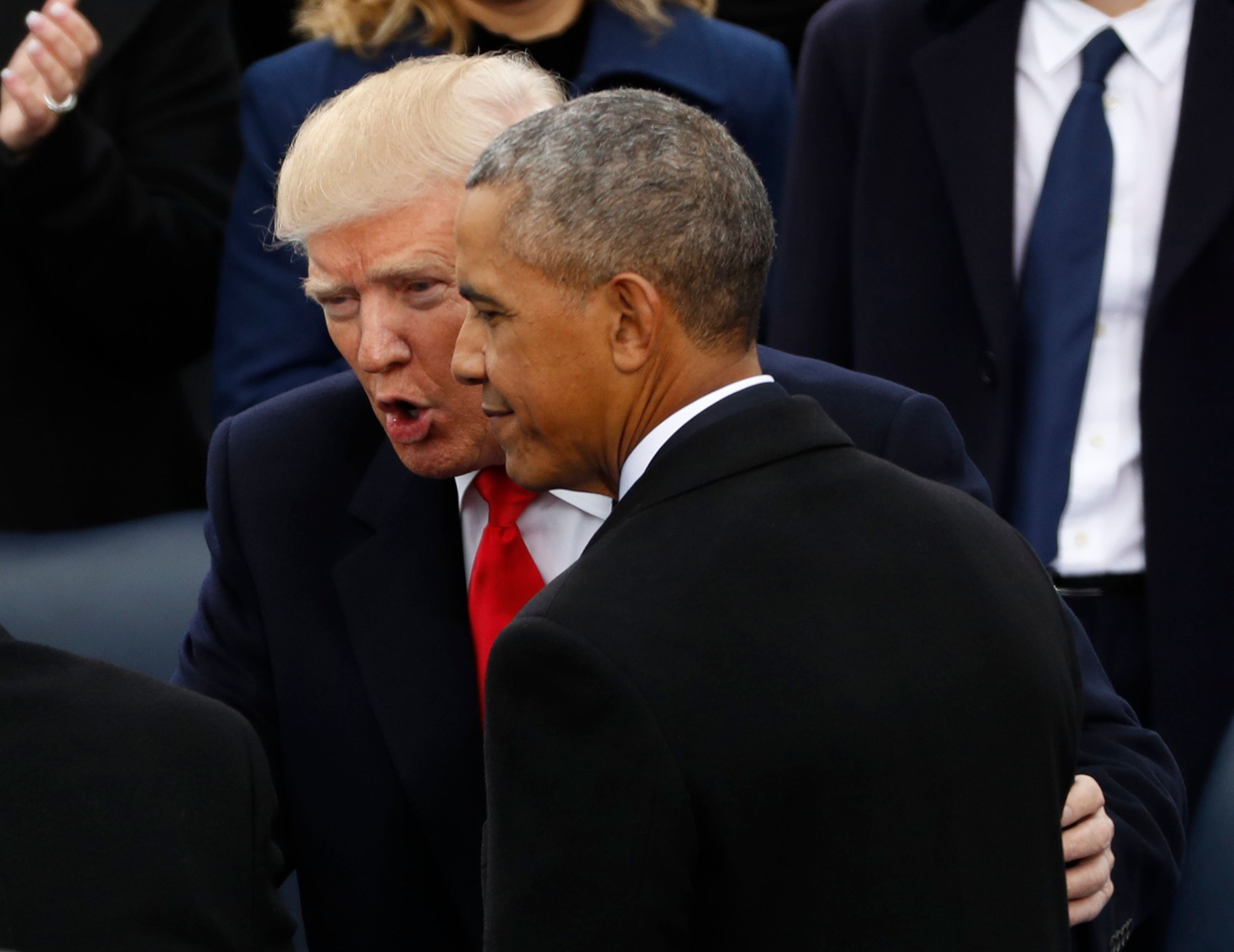 U.S. President-elect Donald Trump (L) talks with U.S. President Barack Obama before inauguration ceremonies swearing in Donald Trump as the 45th president of the United States on the West front of the U.S. Capitol in Washington, DC, U.S., January 20, 2017. REUTERS/Kevin Lamarque