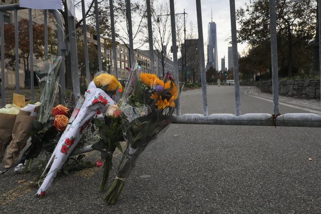 A makeshift memorial stands on a bike path in lower Manhattan on November 1, 2017 in New York City. Eight...