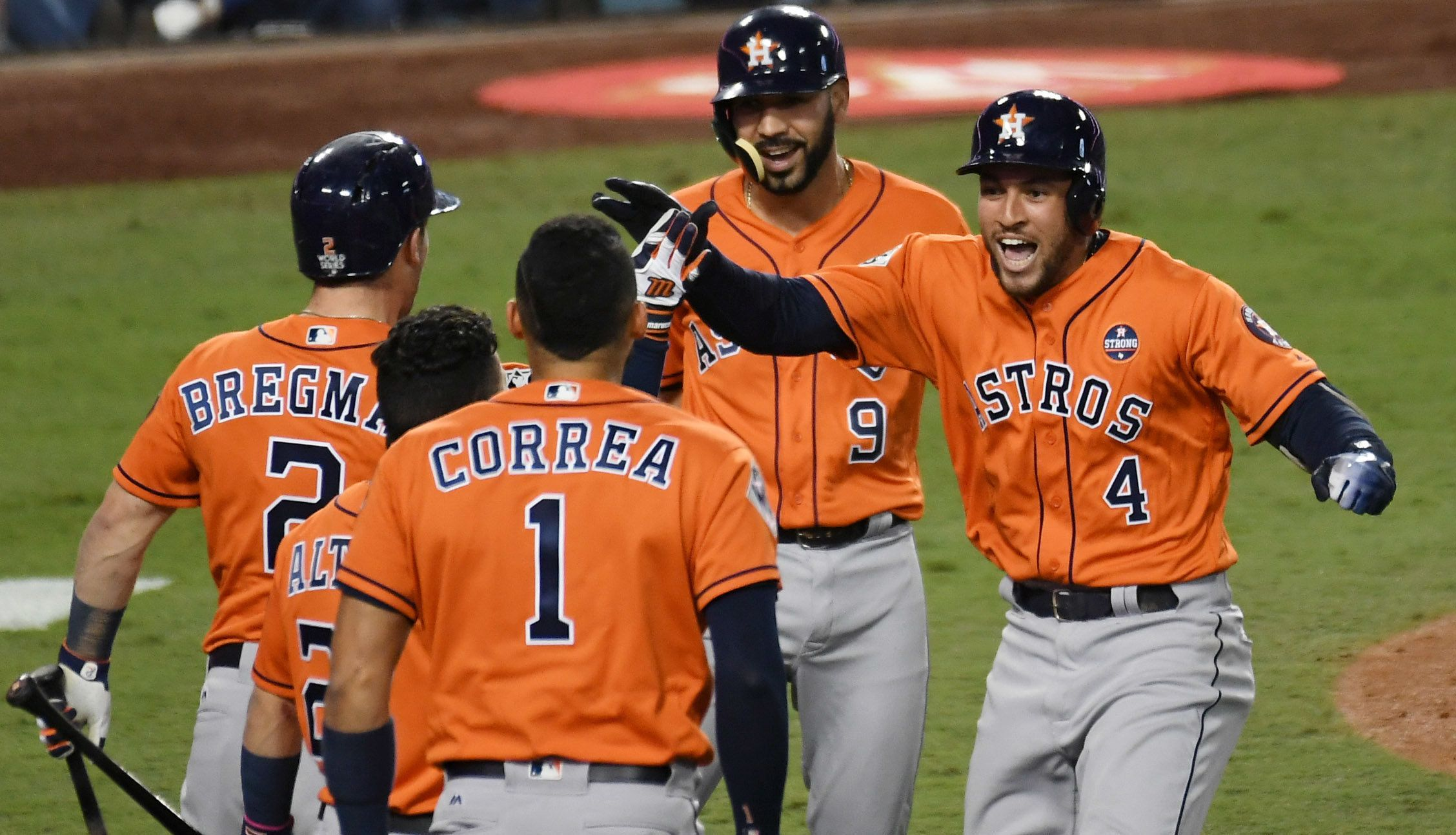 Nov 1, 2017; Los Angeles, CA, USA; Houston Astros center fielder George Springer (4) celebrates with left fielder Marwin Gonzalez (9) and third baseman Alex Bregman (2) and shortstop Carlos Correa (1) after scoring on his two run home run against the Los Angeles Dodgers in the second inning in game seven of the 2017 World Series at Dodger Stadium. Mandatory Credit: Richard Mackson-USA TODAY Sports