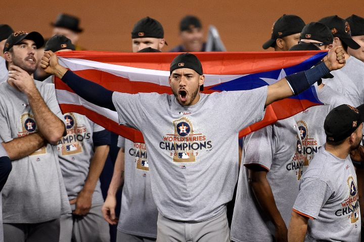 Correa celebrates winning the World Series.