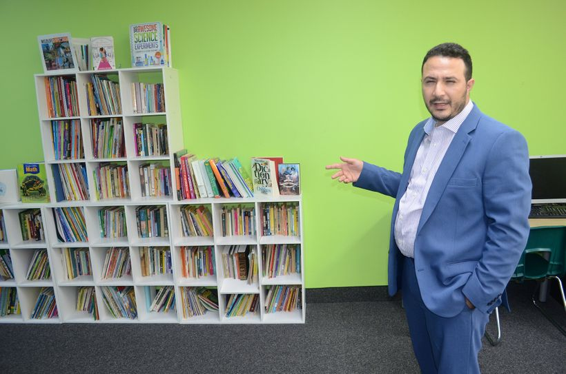 Hussein Hachem of Dearborn, Mich. shows off his Educare tutoring facility called 'Educare.' Many of the books were purchased