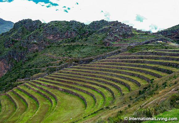Sacred Valley, Pisac. Farm terraces and village. Pisac, Peru.