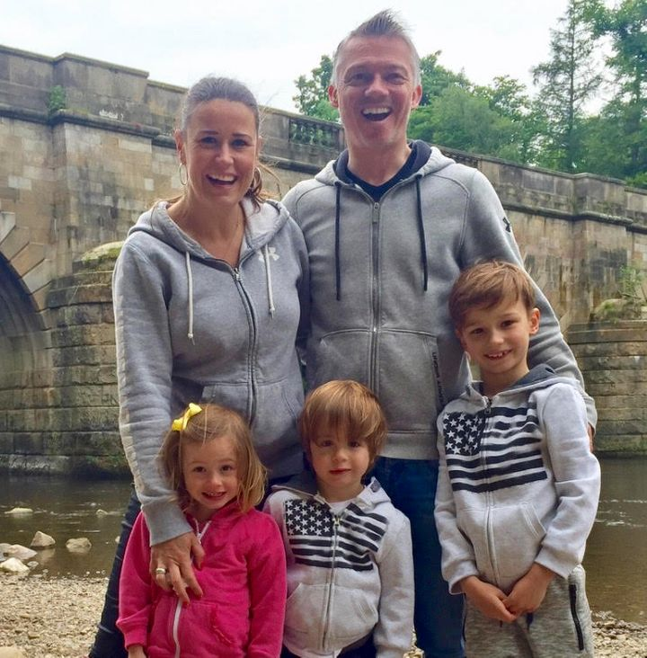Helen Davis with her partner and children, nine-year-old Zac and four-year-old twins Anya and Xavi.