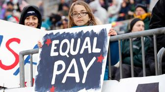 06 April 2016: A young USA fan with a message on equality in pay. The United States womens national soccer team defeated the womens national team of Colombia 7-0 in an international friendly at Pratt & Whitney Stadium at Rentschler Field in East Hartford, Connecticut. (Photo by Fred Kfoury III/Icon Sportswire via Getty Images)