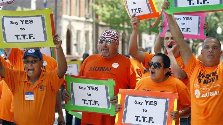 New Jersey construction workers rally in favor of a gas tax hike, which was enacted. The increase was packaged with the elimi