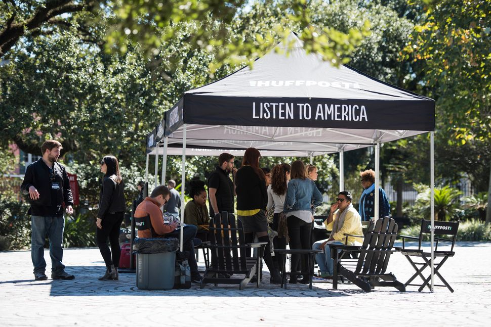 People arrive at the Listen to America tents during HuffPost's visit to New Orleans.