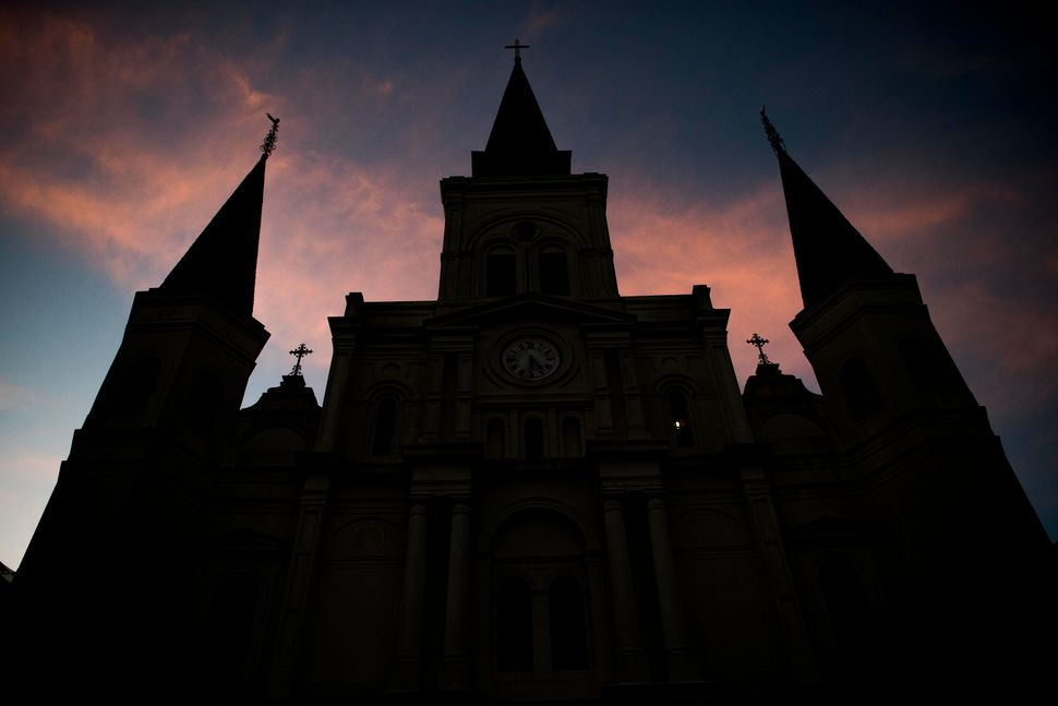 The St. Louis Cathedral in New Orleans reflects the city's French and Catholic heritage.