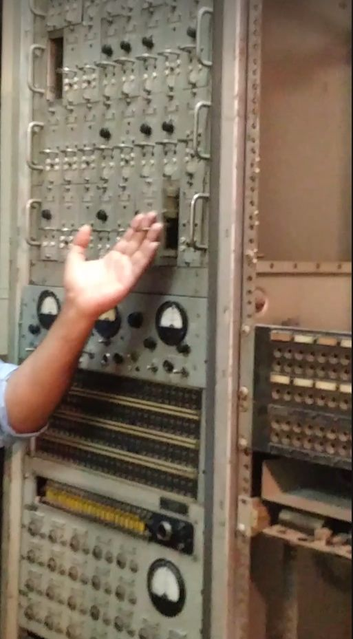 Tour guide handles electronic equipment found within the former embassy.