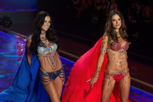 Models Adriana Lima (L) and Alessandra Ambrosio wearing the Mouawad Fantasy Bra walk the runway at the annual Victoria's Secr