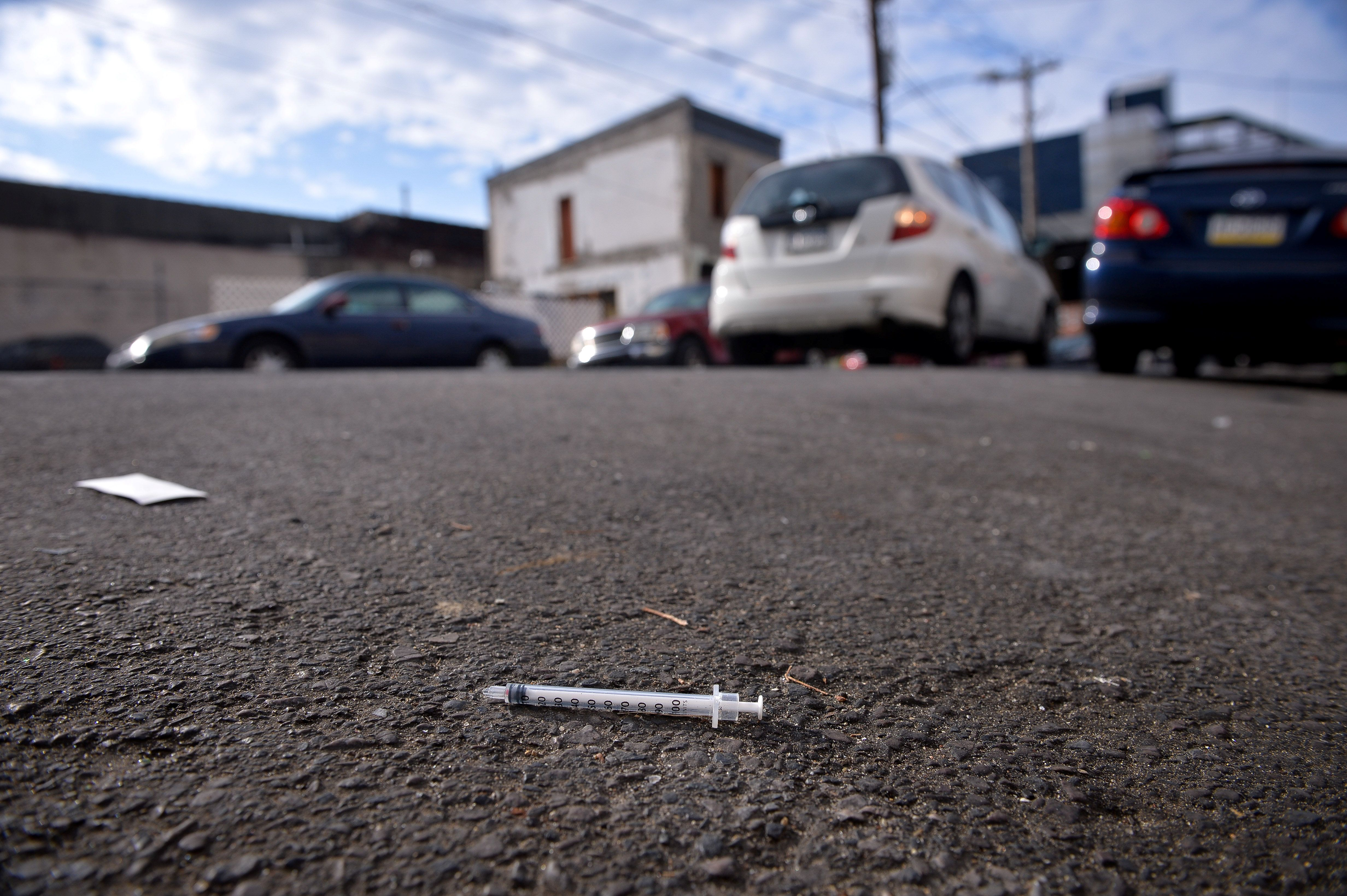 A needle used for shooting heroin and other opioids lies in the street in the Kensington section of Philadelphia, Pennsylvania, U.S., October 26, 2017. REUTERS/Charles Mostoller