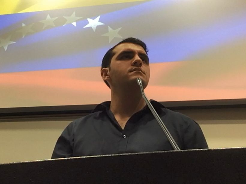 Jorge speaking at a campus event about the atrocities of the Maduro regime.