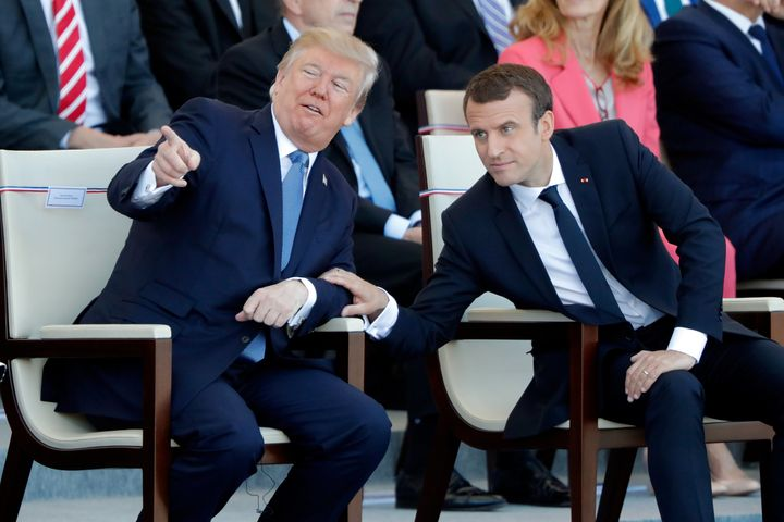 French President Emmanuel Macron and U.S. President Donald Trump attend the traditional Bastille Day military parade on the C