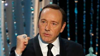 Kevin Spacey accepts an award for Outstanding Performance by a Male Actor in a Drama Series for his role in House of Cards at the Screen Actors Guild Awards in Los Angeles early last year