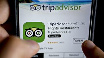 The TripAdvisor Inc. application is seen in the App Store on an Apple Inc. iPhone in this arranged photograph taken in Washington, D.C., U.S., on Friday, May 5, 2017. TripAdvisor is scheduled to released earnings figures on May 9. Photographer: Andrew Harrer/Bloomberg via Getty Images