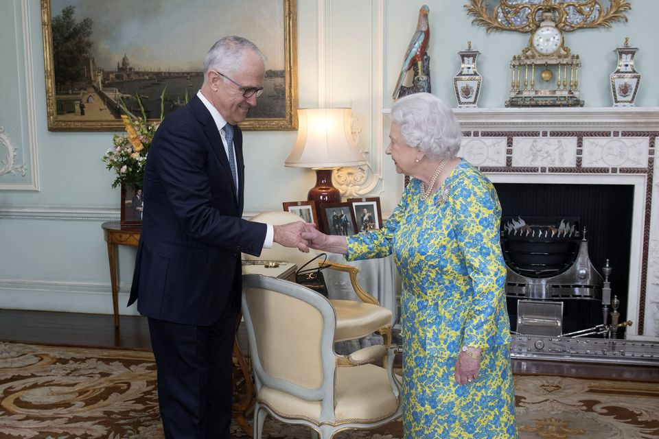 Malcolm Turnbull shakes Queen Elizabeth II's hand during an audience at Buckingham Palace this