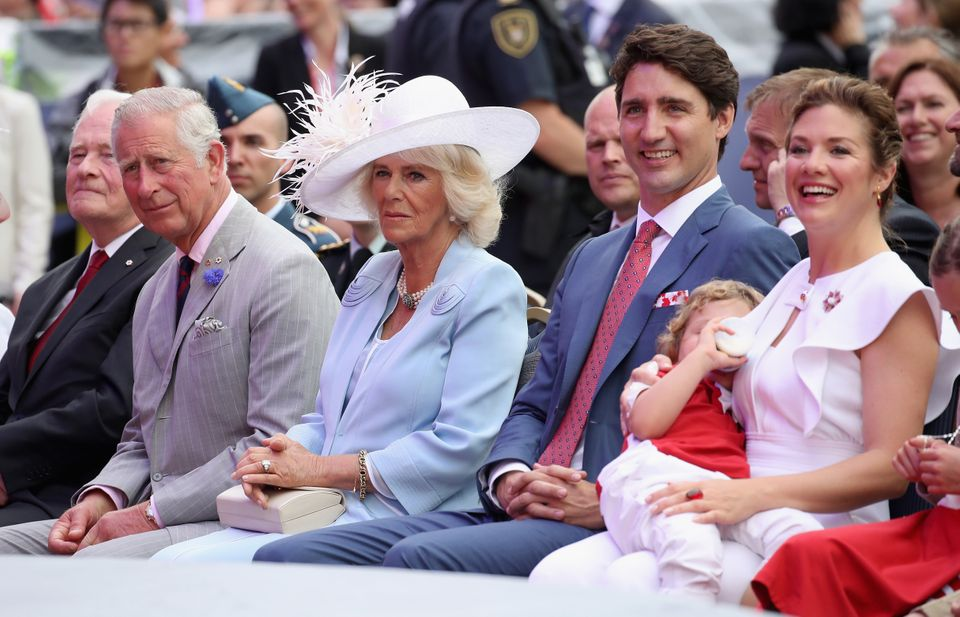 Charles, Prince of Wales, and Camilla, Duchess of Cornwall, sit alongside Canadian PM Justin Trudeau...