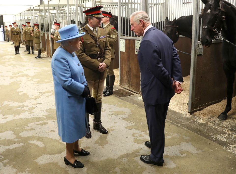 The Queen and Prince Charles on a tour of the Household Cavalry Mounted Regiment barracks near Hyde Park...