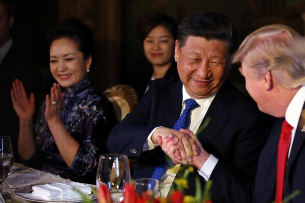Chinese President Xi Jinping shakes trump's hand during a dinner at the start of a summit at the president's...