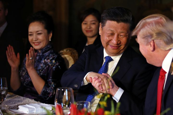 Chinese President Xi Jinping shakes trump's hand during a dinner at the start of a summit at the president's Mar-a-Lago estat