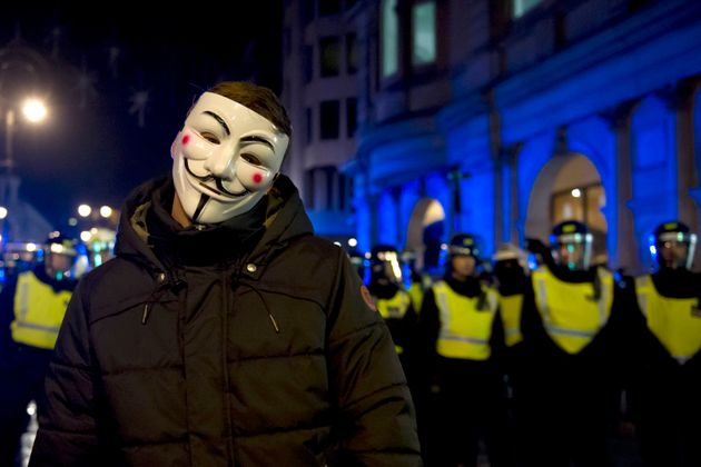 Protestors demonstrate on The Strand, London, during the Million Mask March bonfire night protest organised...