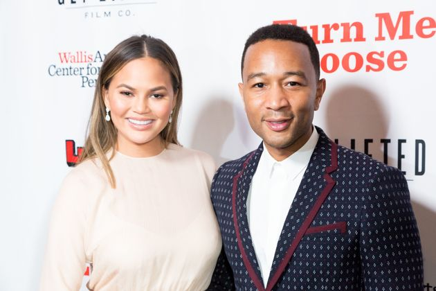 Chrissy Teigen, pictured with husband John Legend on Oct. 19, left one ginormous