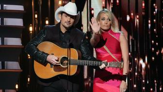 NASHVILLE, TN - NOVEMBER 04:  Brad Paisley and Carrie Underwood perform during the 49th annual CMA Awards at the Bridgestone Arena on November 4, 2015 in Nashville, Tennessee.  (Photo by Taylor Hill/Getty Images)