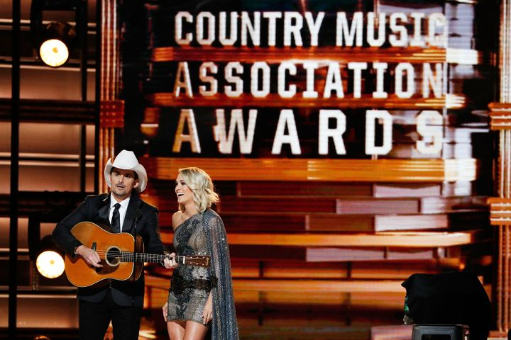 Brad Paisley and Carrie Underwood appear onstage at the 2016 CMA Awards.