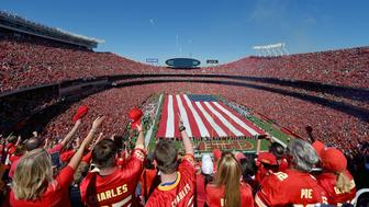 Kansas City Chiefs fans salute at the end of the National Anthem as a B2 stealth bomber and fireworks fly overhead before Sunday's football game against the San Diego Chargers on Sunday, Sept. 11, 2016 at Arrowhead Stadium in Kansas City, Mo. (John Sleezer/Kansas City Star/TNS via Getty Images)
