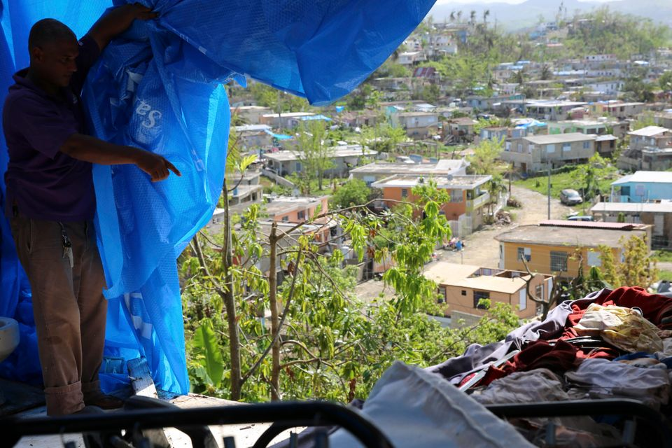 Danny Guerrero Herrera in mid-October shows HuffPost what's behind the blue tarp a charitable organization...