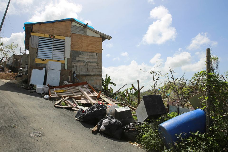 Debris gathers on the streets in Canóvanas, Puerto Rico on Oct. 14,