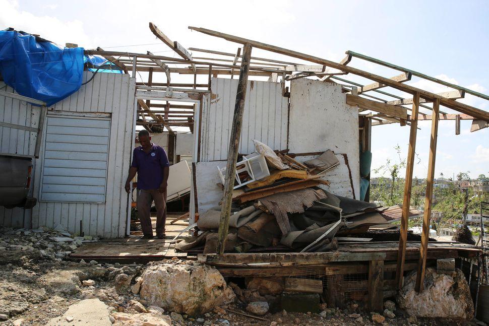 Guerrero Herrera stands in front of what's left of his home.