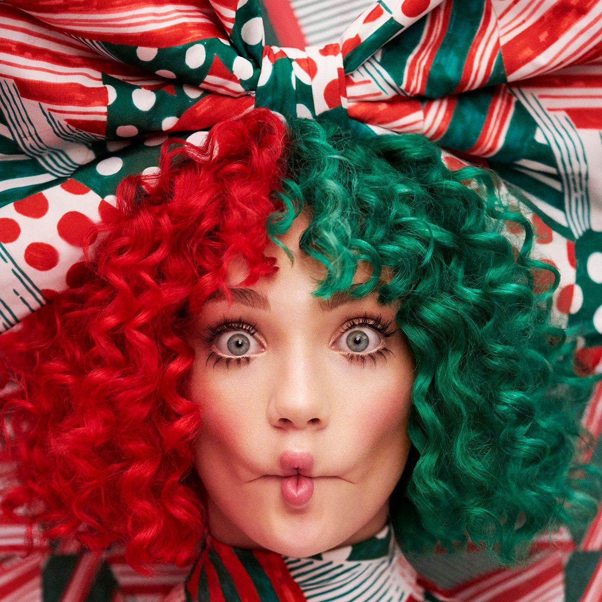 Frequent Sia collaborator Maddie Ziegler appears on the cover of Sia's holiday album,