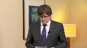 "Sacked Catalan President Carles Puigdemont makes a statement in this still image from video calling for the release of ""the legitimate government of Catalonia"", after a Spanish judge ordered nine Catalan secessionist leaders to be held in custody pending a potential trial over the region's independence push, in Brussels, Belgium, November 2, 2017.    TV3  via REUTERS TV SPAIN OUT. NO COMMERCIAL OR EDITORIAL SALES IN SPAIN"