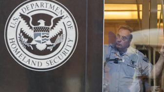 A security officer looks out of a window at the US Immigration and Customs Enforcement (ICE)  office, part of the Department of Homeland Security (DHS),  in Washington DC on October 4, 2017. / AFP PHOTO / ANDREW CABALLERO-REYNOLDS        (Photo credit should read ANDREW CABALLERO-REYNOLDS/AFP/Getty Images)