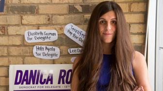 Danica Roem, a Democrat for Delegate in Virginia's district 13, and who is transgender, sits in her campaign office on September 22, 2017, in Manassas, Virginia. 'Look at the inside of my shoe, ok?' replies Danica Roem when asked how many voters she has already approached in her bid to win a Virginia statehouse seat.The Democratic candidate has no time for subtleties as she races to become the first openly transgender person elected to office in this Republican US state. Whether spitting in the trashcan during a recent interview with Cosmopolitan magazine or whipping off her ballerina flat to show its worn insole to AFP, this young woman does not shy from flaunting her working-class roots.  / AFP PHOTO / Paul J. RICHARDS / TO GO WITH AFP STORY -'Transgender metalhead makes historic political office bid'        (Photo credit should read PAUL J. RICHARDS/AFP/Getty Images)