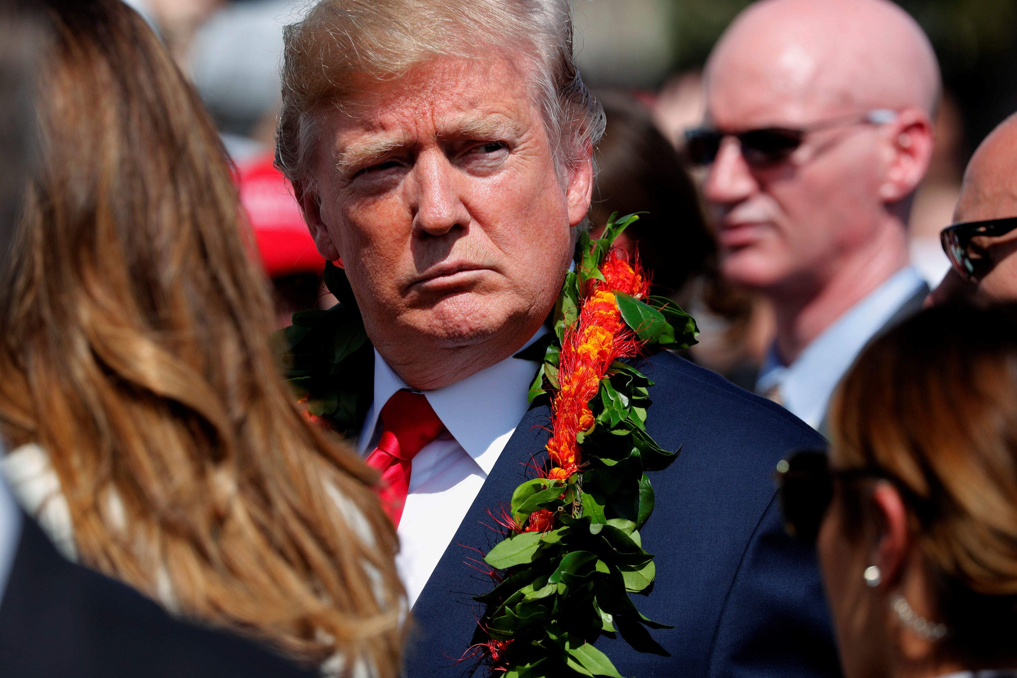 Donald Trump get a lei after landing in Hawaii Friday