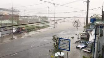 A storm batters a street in Nha Trang as Typhoon Damrey descends on southern Vietnam in this still image taken from social media video November 4 2017