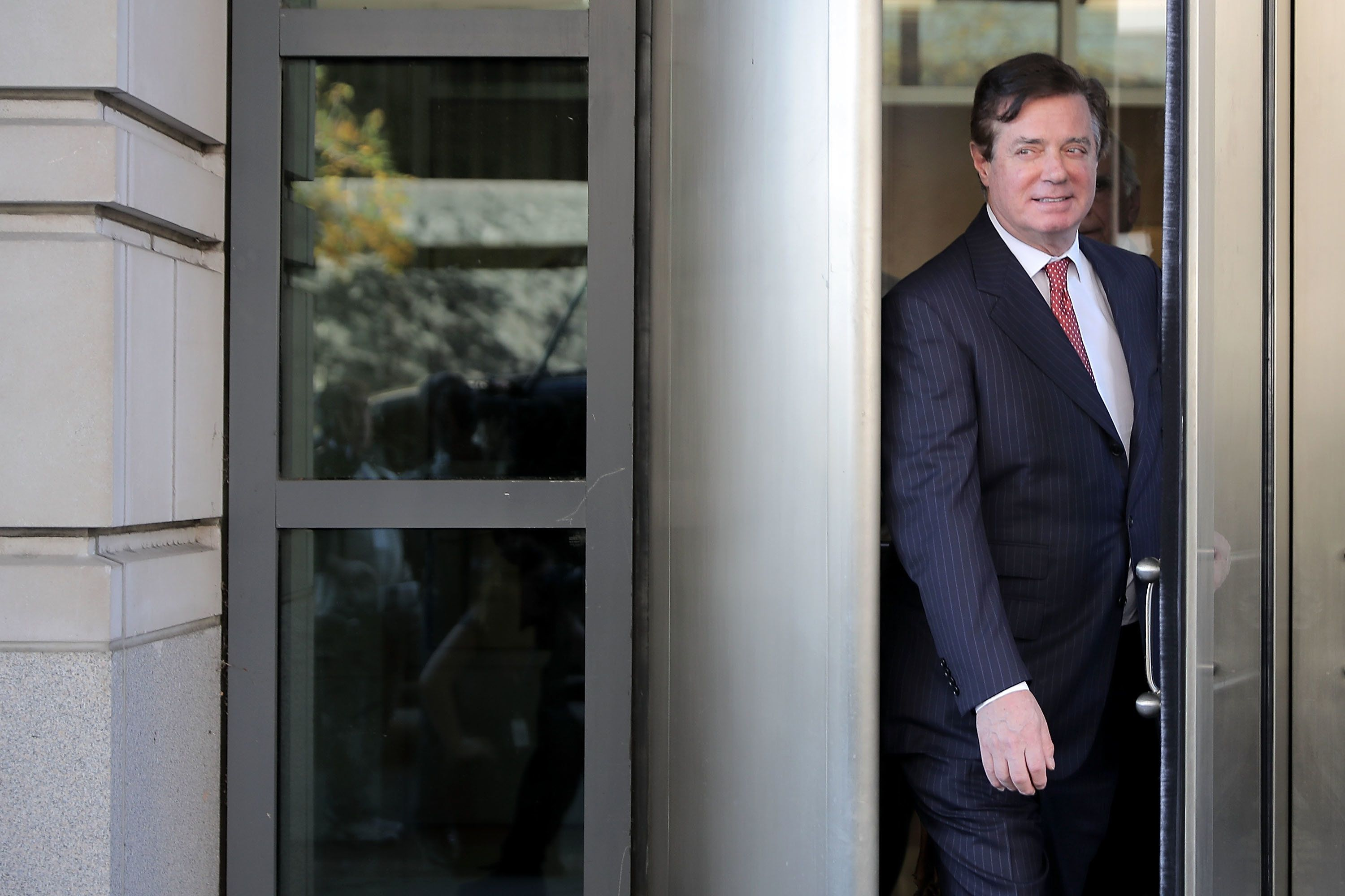 WASHINGTON, DC - NOVEMBER 02:  Former Trump campaign manager Paul Manafort leaves the Prettyman Federal Courthouse following a hearing November 2, 2017 in Washington, DC.  Manafort and his former business partner Richard Gates both pleaded not guilty Monday to a 12-charge indictment that included money laundering and conspiracy.  (Photo by Chip Somodevilla/Getty Images)