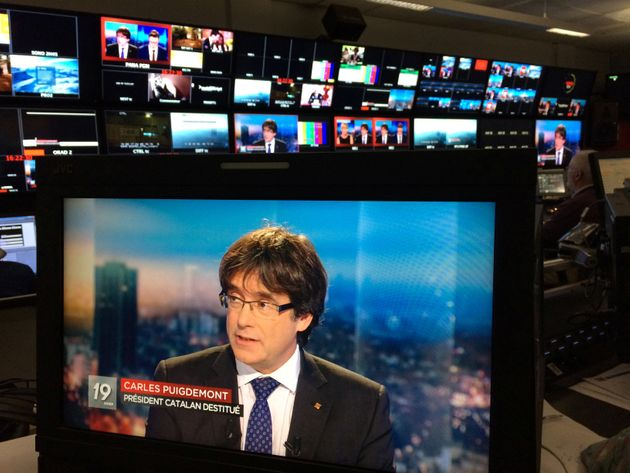 Puigdemont on a monitor as he is interviewed on Belgian TV last