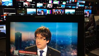 REFILE - CORRECTING BYLINE AND LOCATION  Ousted Catalan President Carles Puigdemont appears on a monitor during a live TV interview at the Belgian RTBF studio in Brussels, Belgium, November 3, 2017.  RTBF Television via REUTERS