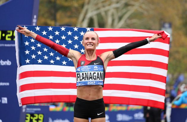 Shalane Flanagan celebrates her victory on Sunday in the New York City